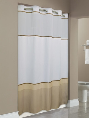 "Available in different styles to complement any decor, the Wellington Hookless® shower curtain is not only handsome - it's also extra durable because it's made for hotels. It installs in seconds and operates smoothly without tugging or snagging. This curtain ""stacks"" beautifully for a neat appearance when pushed to the side. The Wellington Hookless® shower curtain with ""It's A Snap""™ liner works with any shower rod, but combine it with The Arc ™ for an elegant upgrade. Add a pop of color and freshen up your bathroom with the Wellington Hookless® shower curtain. It features a taupe color block pattern on 100% polyester fabric with a coordinating satin trim.  Matching flat Flex-On® rings. Coordinating poly-voile translucent window. Includes It's A Snap!® replaceable liner. It's A Snap!® liner features ultrasonic bottom cut to prevent mildew buildup and weighted corner magnets. 71 x 74 71 x 77  Call 855-468-3528 or click here to email us about large quantity purchases."