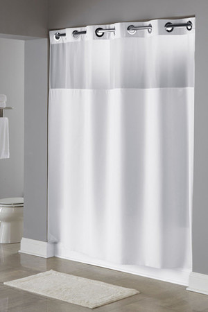 "Available in different styles to complement any decor, the Illusion Hookless® shower curtain is not only handsome - it's also extra durable because it's made for hotels. The Illusion Hookless® shower curtain installs in seconds and operates smoothly without tugging or snagging. The Illusion Hookless® shower curtain curtain ""stacks"" beautifully for a neat appearance when pushed to the side. The Illusion Hookless® shower curtain works with any shower rod, but combine it with The Arc ™ for an elegant upgrade. The Illusion Hookless® shower curtain combines the sleek simplicity of our plainweave 100% polyester fabric with many valuable features.  Chrome raised Flex-On® rings. Coordinating poly-voile translucent window. Includes It's A Snap!® replaceable liner. It's A Snap!® liner features ultrasonic bottom cut to prevent mildew buildup and weighted corner magnets.  Call 855-468-3528 or click here to email us about large quantity purchases."