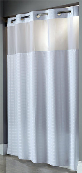 "Available in different styles to complement any decor, the Madison Hookless® shower curtain is not only handsome - it's also extra durable because it's made for hotels. It installs in seconds and operates smoothly without tugging or snagging. This curtain ""stacks"" beautifully for a neat appearance when pushed to the side. The Madison Hookless® shower curtain works with any shower rod, but combine it with The Arc ™ for an elegant upgrade. The Madison Hookless® shower curtain features a contemporary rectangular pattern and a sheer window to help bring elegance into your home.   100% Polyester fabric with sheer fabric window Tone-on-tone contemporary rectangular pattern Weighted corner magnets Color matched Flex-On rings allow 10 second installation without removing the shower rod 71 by 74 inches 71 by 77 inches Available only in white Call 855-468-3528 or click here to email us about large quantity purchases."