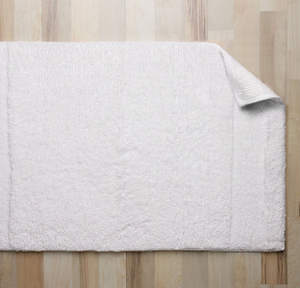"""The City Solid® Bath Rug is super delicate, 100% cotton tufted bath rug with Japanese high-warm resin, non-slip backing is the perfect bath mat for any environment, 20""""x30"""".   Call 855-468-3528 or click here to email us about large quantity purchases."""