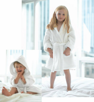 Shawl Collar Robes in CPSC approved flame retardent looped microfiber terry.  Available only in white. (worn by girl)  Call 855-468-3528 or click here to email us about large quantity purchases.