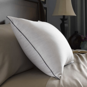"""The Feather Double DownAround® pillows are featured in over one million hotel rooms nationwide, this pillow-in-a-pillow design combines fluffy down and resilient feathers for a comfort encounter like no other - steady yet brilliantly delicate and welcoming. The Feather Double DownAround® pillow is the ideal match for innerspring mattresses because it works in the same manner: An inner pillow of springy feathers is surrounded by fluffy, cushioning down.     300 thread count, AllerRest Fabric® blocks dust mites Pillow-in-a-pillow design Hyperclean® Pacific Coast® down and Eurofeather® fill   Design Pillow-in-a-pillow design Double needle stitched edge for durability Navy blue cording  Fabric 300 thread count,100% cotton AllerRest Fabric® Barrier Weave™ - Specially woven to prevent down & feathers from sneaking out Navy corded, double-needled stitched edge  Dimensions Standard - 20"""" x 26"""" Queen - 20"""" x 30"""" King - 20"""" x 36""""  Call 855-468-3528 or click here to email us about large quantity purchases.  (Note: The digital images we display have the most accurate color possible. However, due to differences in computer monitors, we cannot be responsible for variations in color between the actual product and your screen.)"""
