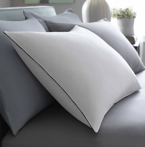 """The Feather Best™ Pillow also known as The Better Feather Pillow, has the combination of extra fluffy feathers covered in super delicate brushed cotton feels mind blowing! The extraordinary obstruction design delivers plume free solace.    Super soft 230 thread count 100% brushed cotton cover Patent pending design inside barrier completely blocks quills Traditional design with blue cording   Design Traditional   Fabric  230 thread count Barrier Weave® fabric 100% brushed cotton   Dimensions SuperStandard - 20"""" x 28"""" King - 20"""" x 36""""   Call 855-468-3528 or click here to email us about large quantity purchases.   (Note: The digital images we display have the most accurate color possible. However, due to differences in computer monitors, we cannot be responsible for variations in color between the actual product and your screen.)"""