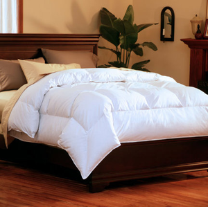 """The SuperLoft™ Down Comforter is fluffier than ordinary comforters because the patented design allows the down inside more space to extend. Each tufted box has additional texture that puffs out to make fluffier chambers.    400 thread count, 100% cotton Barrier Weave™ fabric 600 fill power HyperClean® Pacific Coast® white duck down SuperLoft™ tufted design Comfort Lock® border Navy blue corded trim Ideal for year round warmth   Twin - 63"""" x 86"""" Full/Queen - 88"""" x 90"""" King - 104"""" x 90""""   Call 855-468-3528 or click here to email us about large quantity purchases.   (Note: The digital images we display have the most accurate color possible. However, due to differences in computer monitors, we cannot be responsible for variations in color between the actual product and your screen.)"""