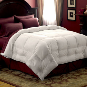 """The Medium Down Comforter has fluffy, light feathers for the all season warmth with its appealing stay-fluffy design, the Medium Down Comforter alluring three-sided Comfort Lock® border prevents shifting, keeping down on top where you need it.     300 thread count 100% cotton Barrier Weave™ fabric 550 fill power Pacific Coast® down True baffle box design Comfort Lock® border Navy blue corded trim Ideal for year round warmth    Twin - 64"""" x 86"""" Full/Queen - 88"""" x 90"""" King - 104"""" x 89""""    Call 855-468-3528 or click here to email us about large quantity purchases.     (Note: The digital images we display have the most accurate color possible. However, due to differences in computer monitors, we cannot be responsible for variations in color between the actual product and your screen.)"""