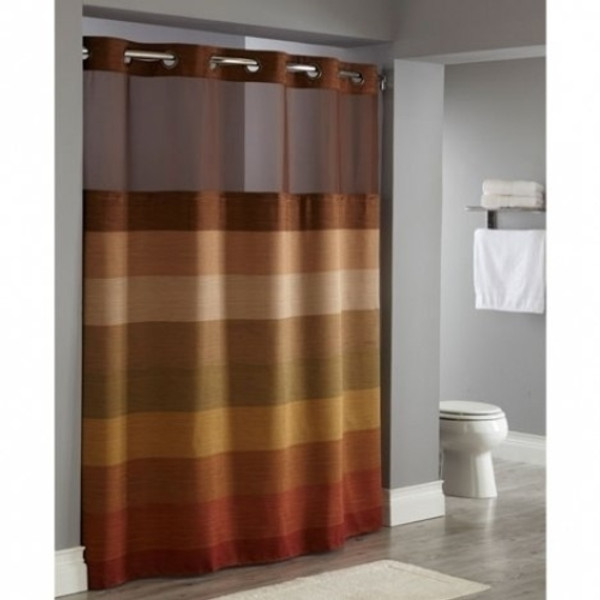 """Available in different styles to complement any decor, the Stratus Window Hookless® shower curtain is not only handsome - it's also extra durable because it's made for hotels. The Stratus Window Hookless® shower curtain installs in seconds and operates smoothly without tugging or snagging. The Stratus Window Hookless® shower curtain curtain """"stacks"""" beautifully for a neat appearance when pushed to the side. The Stratus Window Hookless® shower curtain with """"It's A Snap""""™ liner works with any shower rod, but combine it with The Arc ™ for an elegant upgrade. The Stratus Window Hookless® features a unique wood-grain jacquard weave in a neutral palette. Made of 100% polyester and accented with bronze finish Hookless® Flex-On® rings and matching translucent window.   Two piece set including Snap-in Liner Unique wood-grain jacquard weave in an earth tone palette Polyester cloth fabric with sheer, matching color poly-voile window Water repellent snap-in liner resists soap scum and minimizes mold and mildew Bronze-finish Flex-On rings allow 10 second installation without removing the shower rod Washable and dry able 71 by 77 inches Call 855-468-3528 or click here to email us about large quantity purchases."""