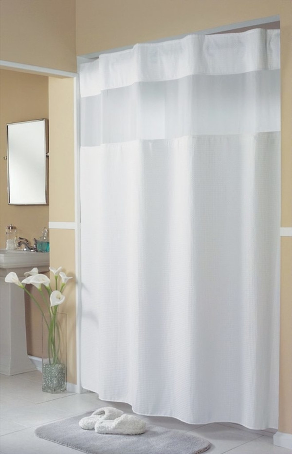 """Available in different styles to complement any decor, the Mini Waffle Weave Hookless® shower curtain is not only handsome - it's also extra durable because it's made for hotels. The Mini Waffle Weave Hookless® shower curtain installs in seconds and operates smoothly without tugging or snagging. The Mini Waffle Weave Hookless® shower curtain """"stacks"""" beautifully for a neat appearance when pushed to the side. The Mini Waffle Weave Hookless® shower curtain with """"It's A Snap""""™ liner works with any shower rod, but combine it with The Arc ™ for an elegant upgrade. The petite spa-like pattern of our Mini Waffle Weave Hookless® shower curtain is constructed of 100% polyester and features the concealed ring header for a sleek appearance.  Bright white, mini waffle weave pattern Polyester cloth fabric Water repellent snap-in liner with heavy duty snaps Treated liner resists soap scum, minimizes mold and mildew Special flap design to prevent leakage Hidden ring construction Washable and dryable 71 x 77 inches Available in white Call 855-468-3528 or click here to email us about large quantity purchases."""