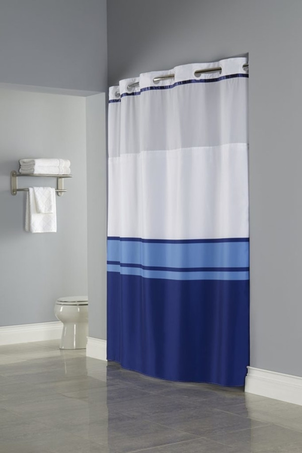 "Available in different styles to complement any decor, the Hookless® shower curtain is not only handsome - it's also extra durable because it's made for hotels. It installs in seconds and operates smoothly without tugging or snagging. This curtain ""stacks"" beautifully for a neat appearance when pushed to the side.   The Brooks Window Hookless® shower curtain with ""It's A Snap""™ liner works with any shower rod, but combine it with The Arc ™ for an elegant upgrade.  Two piece set including Snap-in Liner Combines a blue color block pattern with a coordinating satin trim  Polyester cloth fabric with sheer, matching color poly-voile window Water repellent snap-in liner resists soap scum and minimizes mold and mildew Matching flat Flex-On® rings Washable and dryable 71 by 77 inches  Call 855-468-3528 or click here to email us about large quantity purchases."
