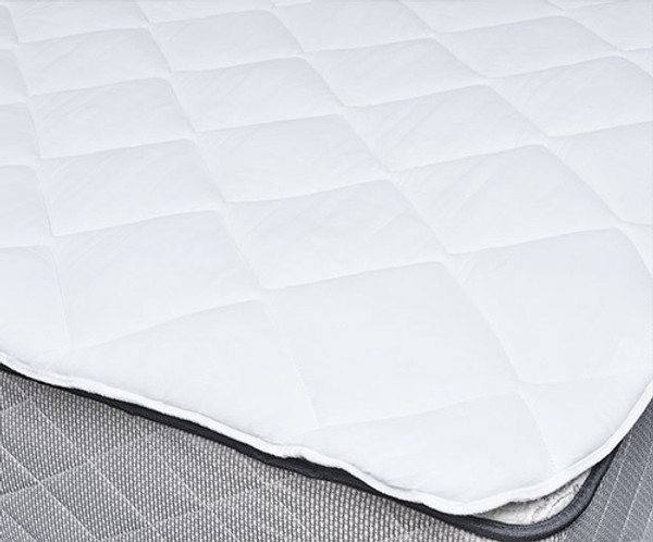 Enjoy extra comfort and protect your bed from spills and stains with the Sleep Supreme Mattress Pad. It's four times thicker than traditional mattress pads and has six times the fill of a normal pad - which helps make your mattress feel like a premium pillow top mattress. - Quilted 50% cotton/50% polyester cover treated with ProGuard(r) for spill and stain protection  - 24 ounces per square yard of bonded polyester fiber  - Hypoallergenic  - Thick elastic anchor bands to hold the topper in place  - Fits mattresses up to 20 inches deep  - Machine washable and dryable  Full: 54 x 80 inches  Queen: 60 x 80 inches  King: 78 x 80 inches California King: 72 x 84 inches  Call 855-468-3528 or click here to email us about large quantity purchases.