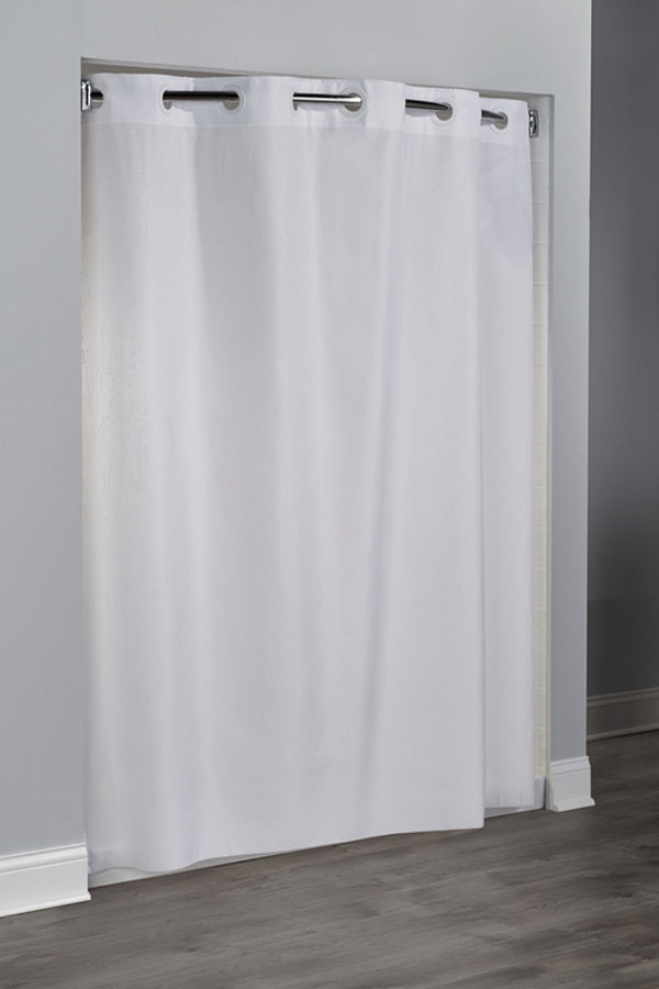 """Available in different styles to complement any decor, the Embossed Moiré Hookless® shower curtain is not only handsome - it's also extra durable because it's made for hotels. Thr Embossed Moiré Hookless® shower curtain  installs in seconds and operates smoothly without tugging or snagging. The Embossed Moiré Hookless® shower curtain  curtain """"stacks"""" beautifully for a neat appearance when pushed to the side. Highlighted by a water-effect tone on tone pattern, the Embossed Moiré Hookless® shower curtain works with any shower rod, but combine it with The Arc ™ for an elegant upgrade.   100% polyester Water repellent Built-in magnets Matching color rings Anti-microbial 71 x 74 inches Available in white & beige Call 855-468-3528 or click here to email us about large quantity purchases."""