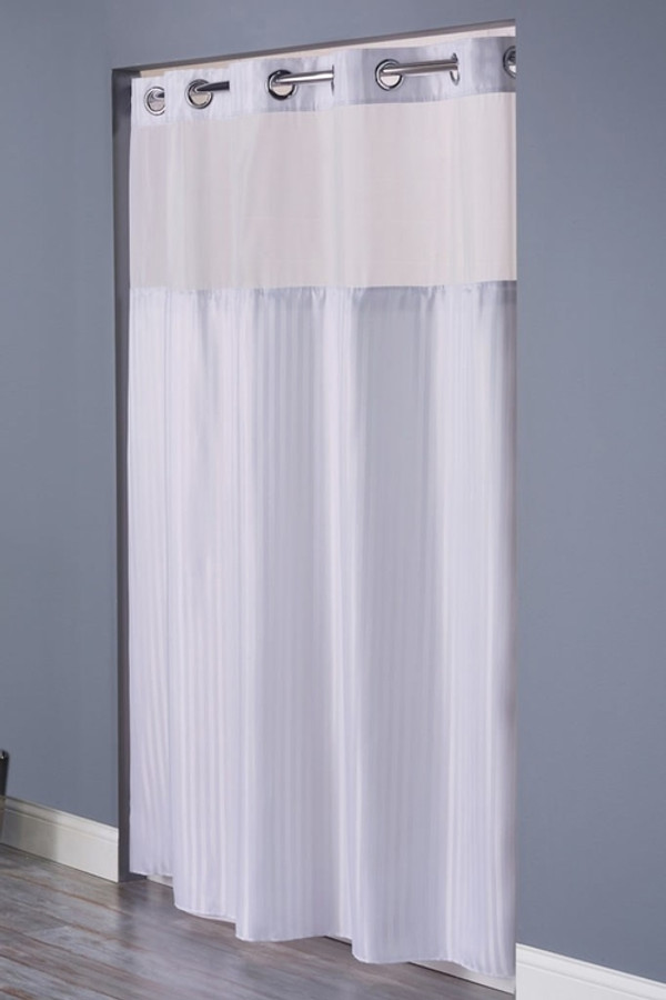 """Available in different styles to complement any decor, the Double H Hookless® shower curtain is not only handsome - it's also extra durable because it's made for hotels. The Double H Hookless® shower curtain installs in seconds and operates smoothly without tugging or snagging.the Double H Hookless® shower curtain """"stacks"""" beautifully for a neat appearance when pushed to the side. The Double H Hookless® shower curtain with """"It's A Snap""""™ liner works with any shower rod, but combine it with The Arc ™ for an elegant upgrade. The Double H Hookless® curtain, a brand standard for many of the leading hotels, is a 1⁄2"""" herringbone weave constructed of 100% polyester.  Tone-on-tone chevron pattern polyester cloth with sheer cloth panel and snap-in liner Water repellent Chrome plated rings Heavy duty snaps with flap to prevent leakage 71 x 77 inches Washable and dryable polyester cloth liner Treated to resist soap scum and minimize mold and mildew Available in white and beige Call 855-468-3528 or click here to email us about large quantity purchases."""