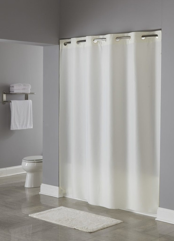 "Available in different styles to complement any decor, the Nylon Hookless® shower curtain is not only handsome - it's also extra durable because it's made for hotels. The Nylon Hookless® shower curtain installs in seconds and operates smoothly without tugging or snagging. The Nylon Hookless® shower curtain curtain ""stacks"" beautifully for a neat appearance when pushed to the side. The Nylon Hookless® shower curtain with ""It's A Snap""™ liner works with any shower rod, but combine it with The Arc ™ for an elegant upgrade. Our original Hookless® Flex-On® rings add functionality to the traditional nylon curtain. Made of 100% nylon.  Strong, durable nylon with subtle  lustre finish Water repellent and stain resistant Reverse bottom hem for smooth water run off Reinforced Safe-T-Top® header Machine washable and dry-able  Call 855-468-3528 or click here to email us about large quantity purchases."