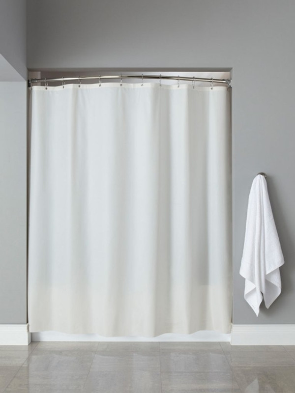 """Available in different styles to complement any decor, the 10-Gauge Basic Vinyl hooked™ shower curtain is not only handsome - it's also extra durable because it's made for hotels.  The 10-Gauge Basic Vinyl hooked™ shower curtain installs in seconds and operates smoothly without tugging or snagging. The10-Gauge Basic Vinyl hooked™ shower curtain """"stacks"""" beautifully for a neat appearance when pushed to the side. This 10-Gauge Basic Vinyl hooked™ shower curtain is constructed of a heavyweight vinyl for increased durability.  Mildew and mold resistant No side bindings or bottom hems - for easy run off and cleaning Rust-proof anodized aluminum grommets Reinforced Safe-T-Top® header 72 x 72 inches Available in white and beige Call 855-468-3528 or click here to email us about large quantity purchases."""