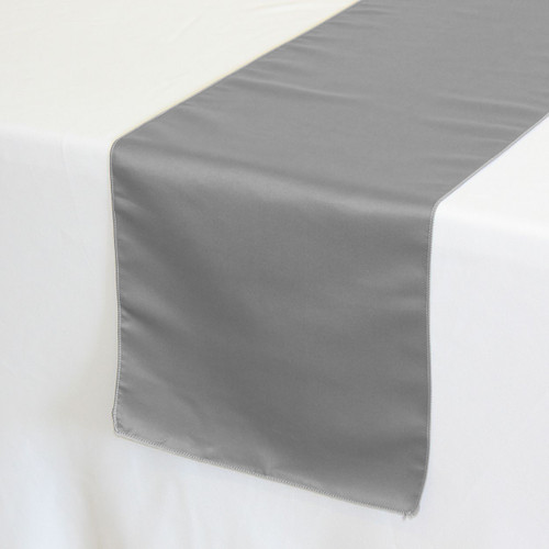 14 x 108 inch Lamour Satin Table Runners in Dark Silver / Platinum on a white tablecloth