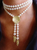 "The Bowl of Diamonds shown here on a pearl lariat with grapes tips.  The lariat is about 48""  twisted into a choker, and secured with the pearl enhancer.  The lariat can be worn many different ways, and the pearl enhancer can be worn on pearls, beads, ribbons and sometimes a chain if it it thick."