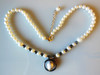 Hematite circling baroque pearl pendant on hematite and pearls.