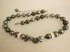Crazy keshi Tahitian pearls on semi round with shark vertebrae highlights