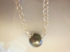 Tahitian Pearl necklace- Side dripped, double mounted round on silver chain.