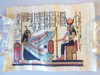 Winged Person & Seated Woman.  Papyrus painting from Egypt in Italian frame.