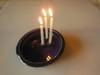 Tamara S Gordon Ceramics. Three candle holding pot - - huh?