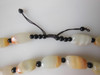 Jade beaded necklace from China.  Black and cream with shades of bronze.