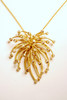 Fireworks Jewelry Collection.  The Superstar Necklace in gold and diamonds.