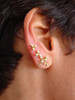 The Fireworks earrings shown stacked, 7 diamond earring, then two 3 diamond earrings,
