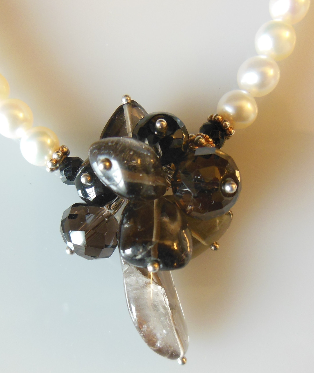 Smoky quartz cluster on white pearls