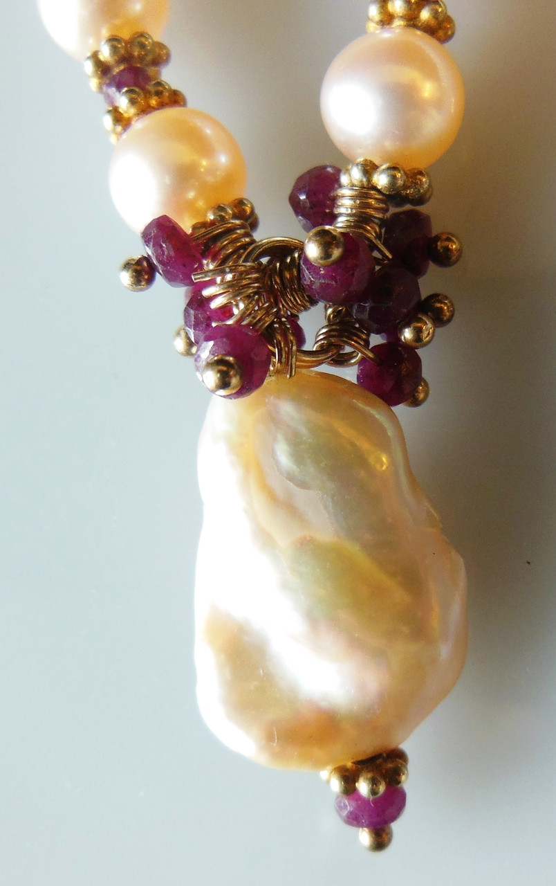 Rubies on baroque and round pearls.