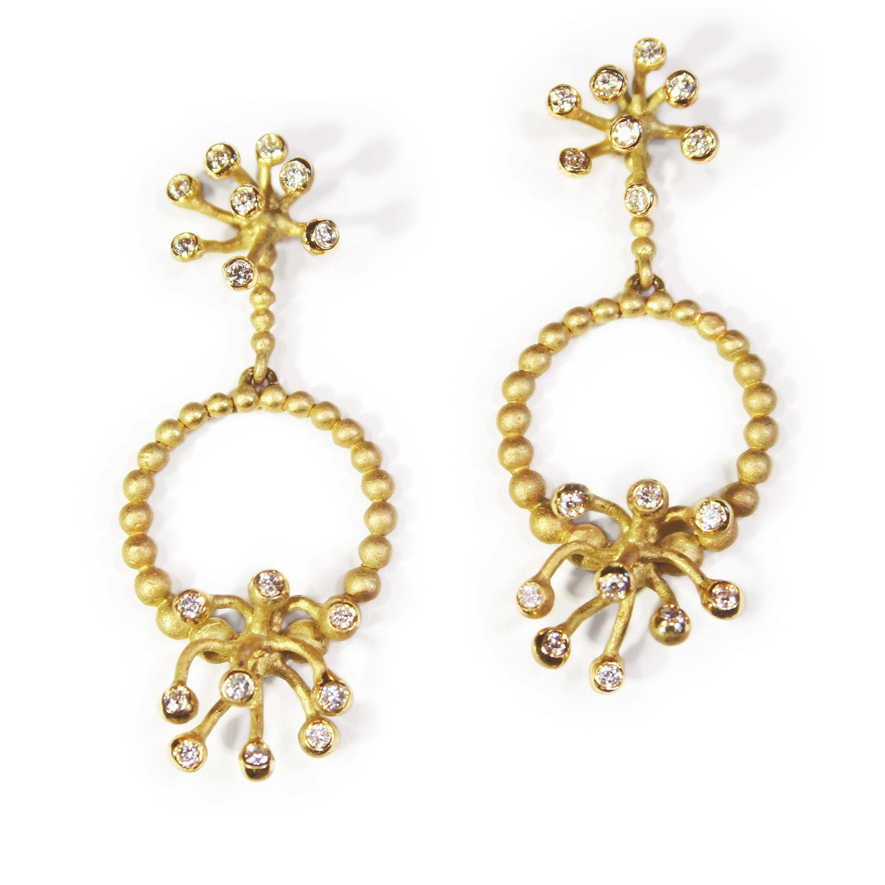 Circle Fireworks gold and diamond earrings.  They come apart and can be worn a variety of ways.