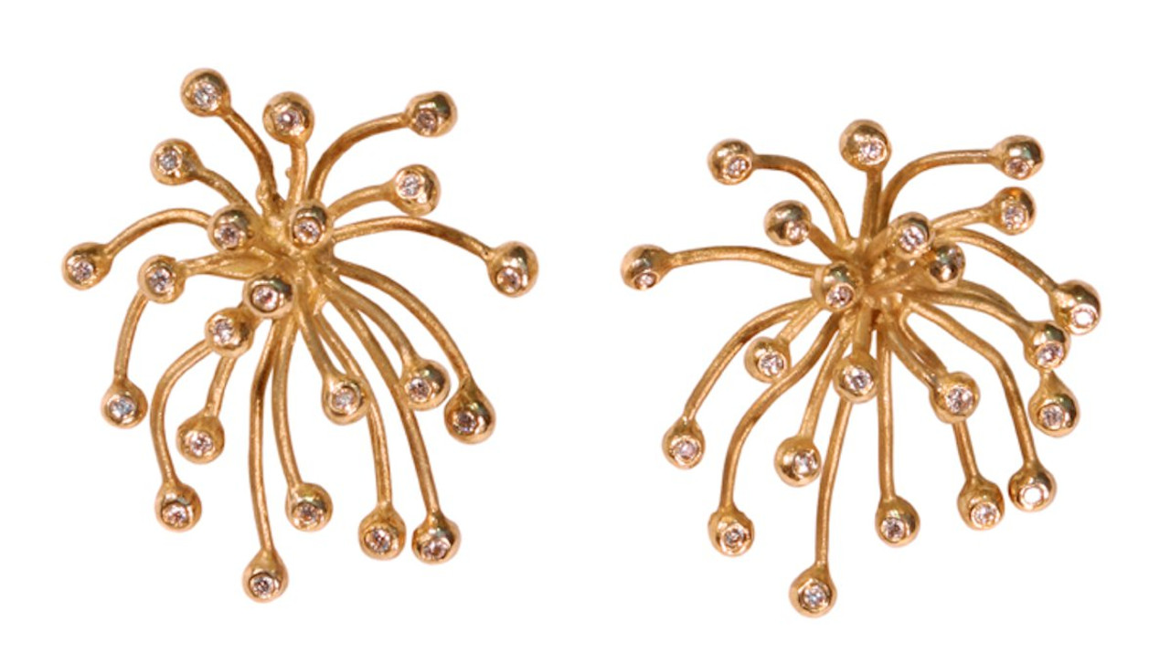 Superstar earrings in gold (or sterling silver with 18K gold plate) from the Fireworks Collection.  Fireworks Earrings and Fireworks Necklaces in many styles many interchangeable.