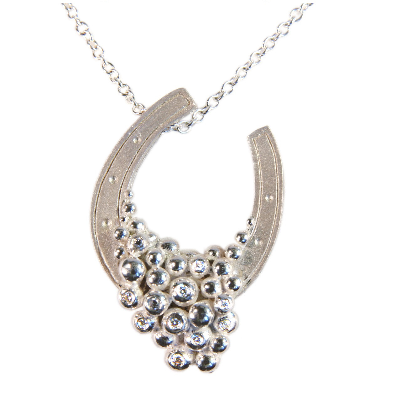 Lucky You Horseshoe necklace in silver - half filled with diamonds.  More can be added later if you wish. The Equestrian jewelry collection.