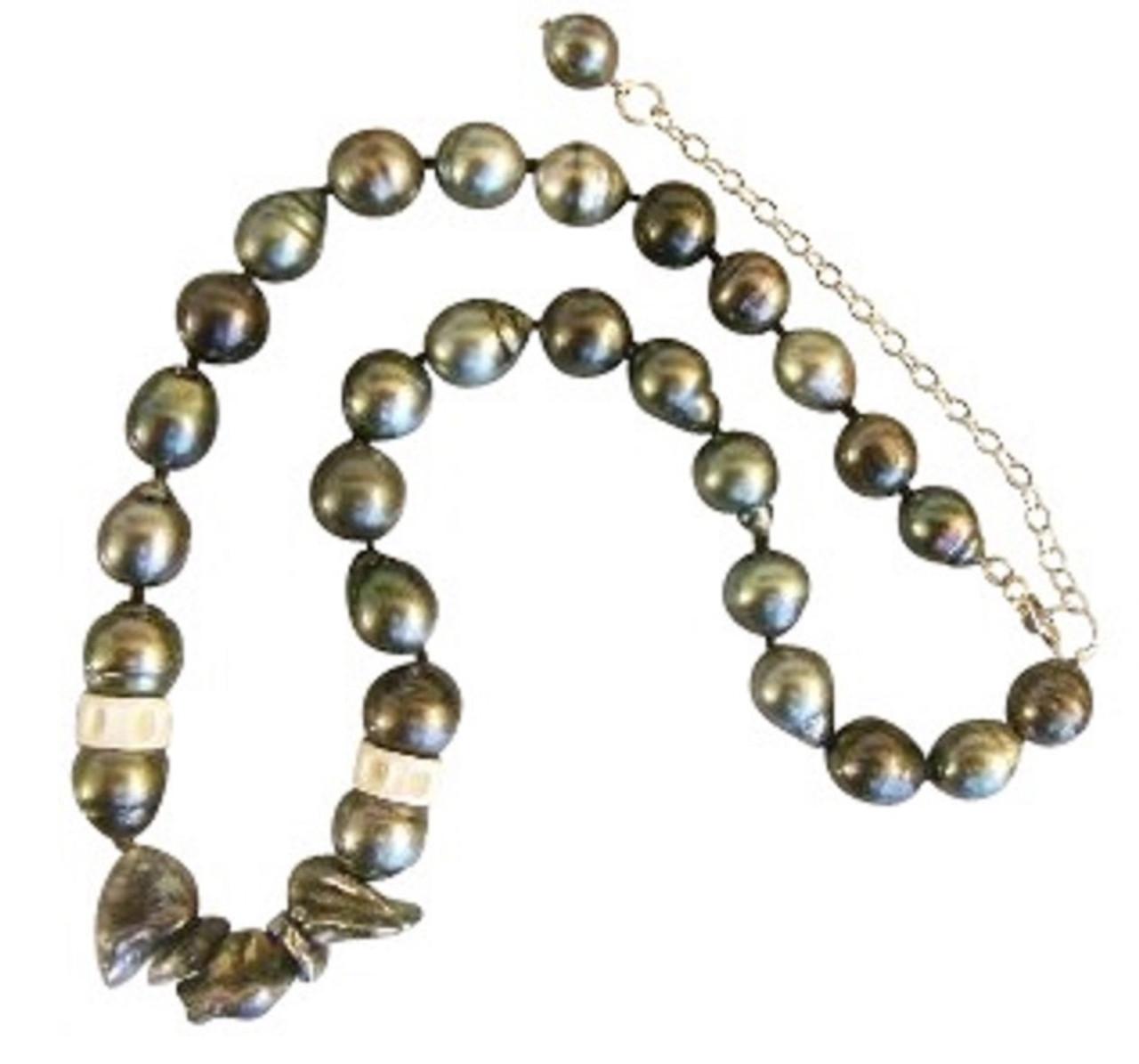 Tahitian pearls, semi round with crazy keshi, and shark vertebrae.