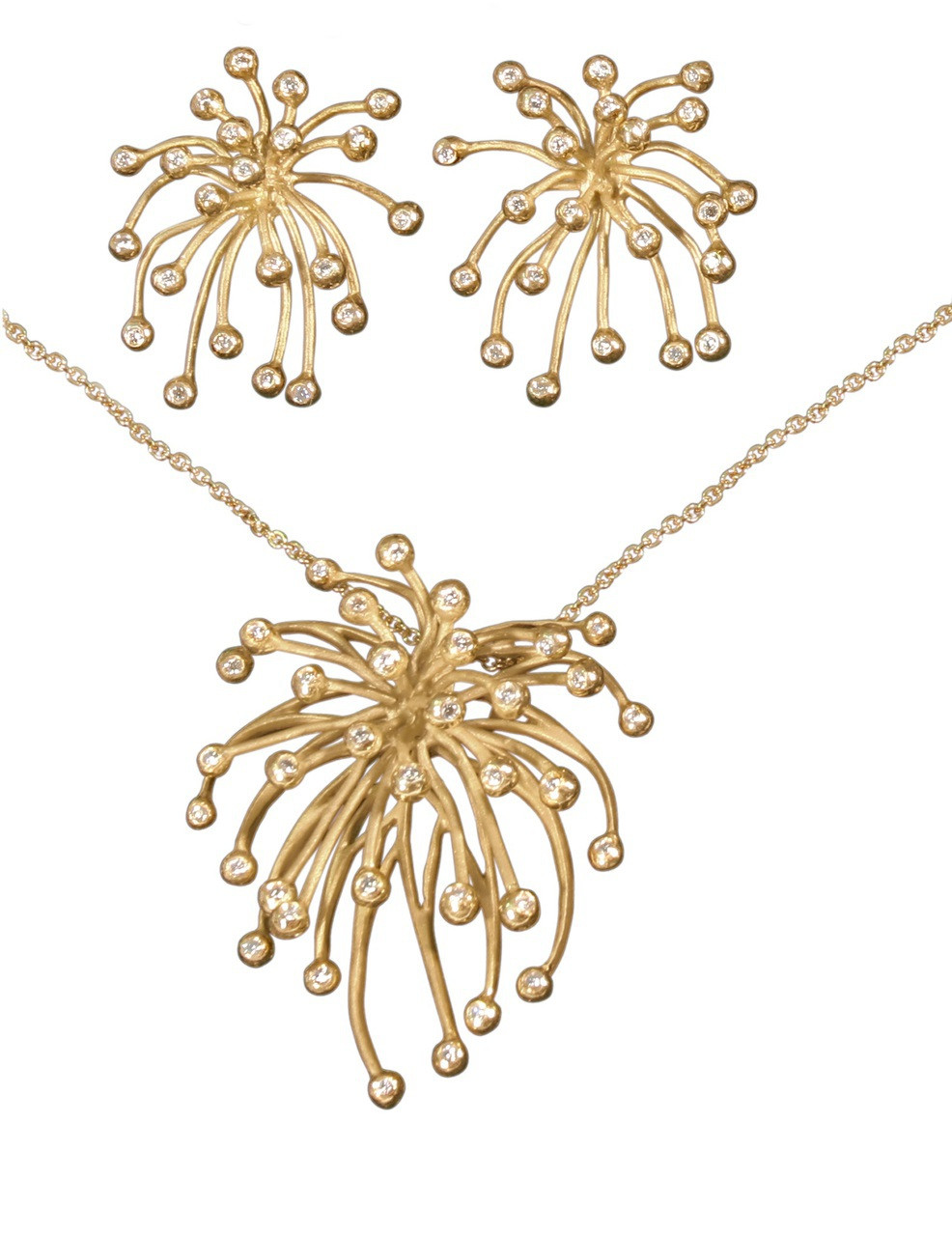 Fireworks Jewelry Collection.  The Superstar Necklace-  with the Superstar Earrings- in gold and diamonds.