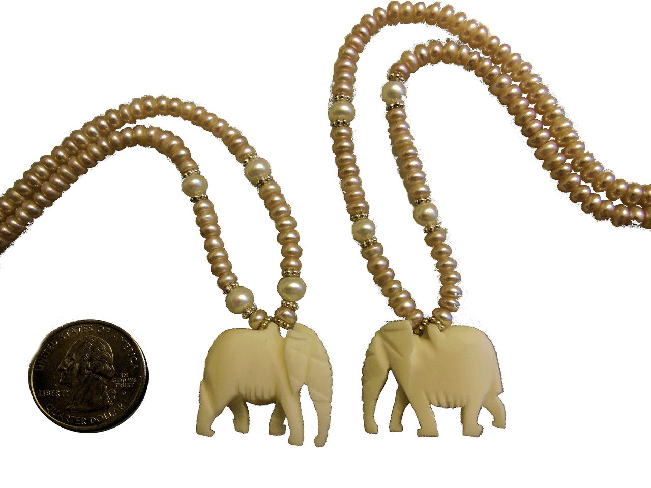 Carved Bone Elephant from Kenya on peach freshwater pearls from China.
