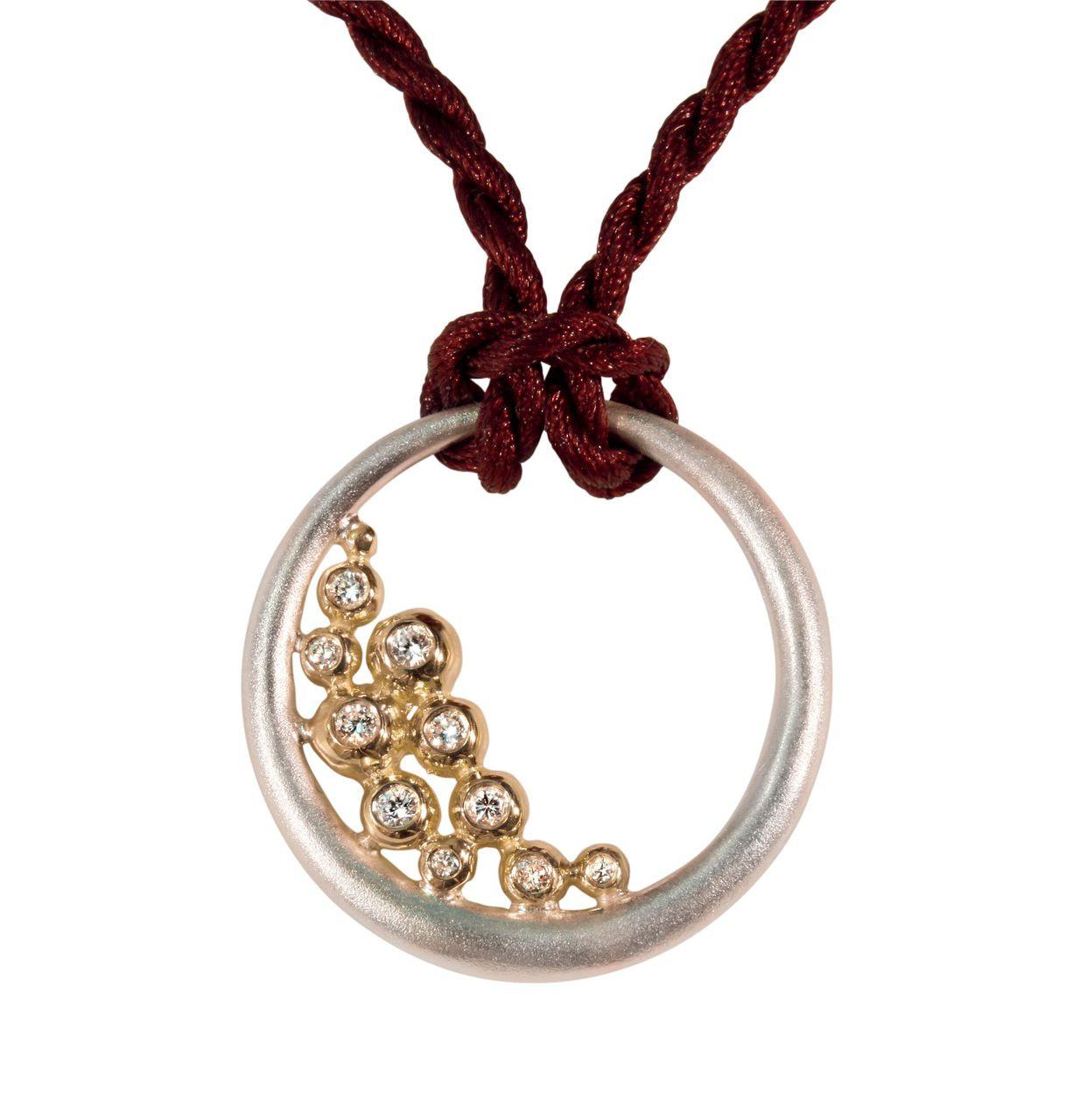 Abundance Circle Pendant: Sterling circle with 18K gold of diamonds.
