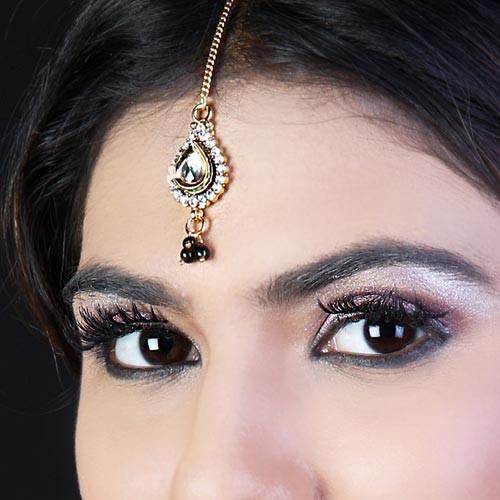 Gold tikka with dark gems