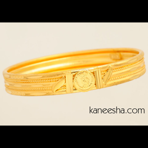 Sumptuously Carved Gold Plated Bangle
