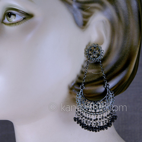 Silver hoop designer earrings. Pierced.