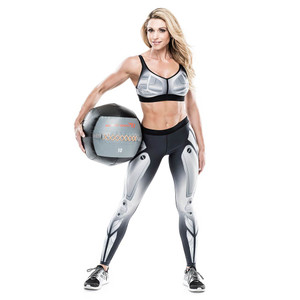 Kim Lyons holding the Bionic Body 10 lb. Medicine Ball