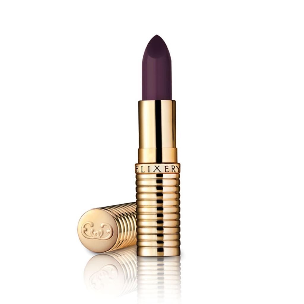 Dark purple lipstick, almost black, in gold container.