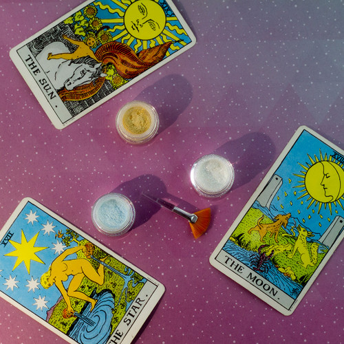 Three sparkling cosmetic  mini-Glimmerdusts(TM) with three tarot cards, the Sun, the Moon and the Star.