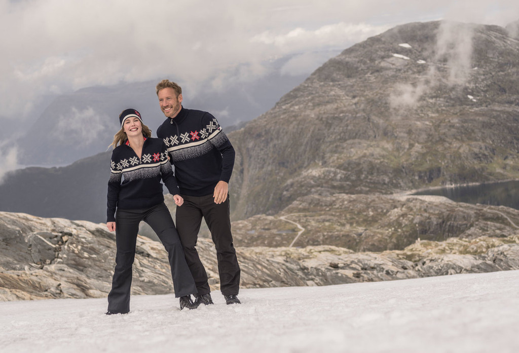 Man and Woman in mountains wearing Dale of Norway's Olympic Passion mens and ladies sweater in Navy/Raspberry/Off White, 93351-C and 93361-C.