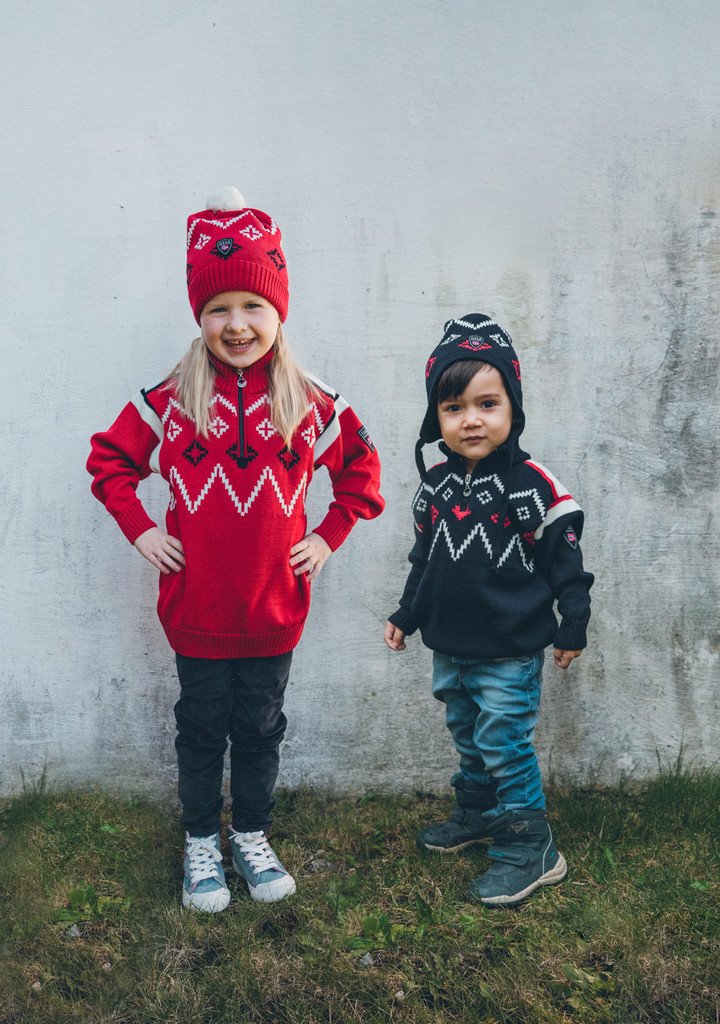 Children wearing Dale of Norway's Seefeld kids pullover in Raspberry/Navy/Off White, 93651-B, and Navy/Raspberry/Off White, 93651-C