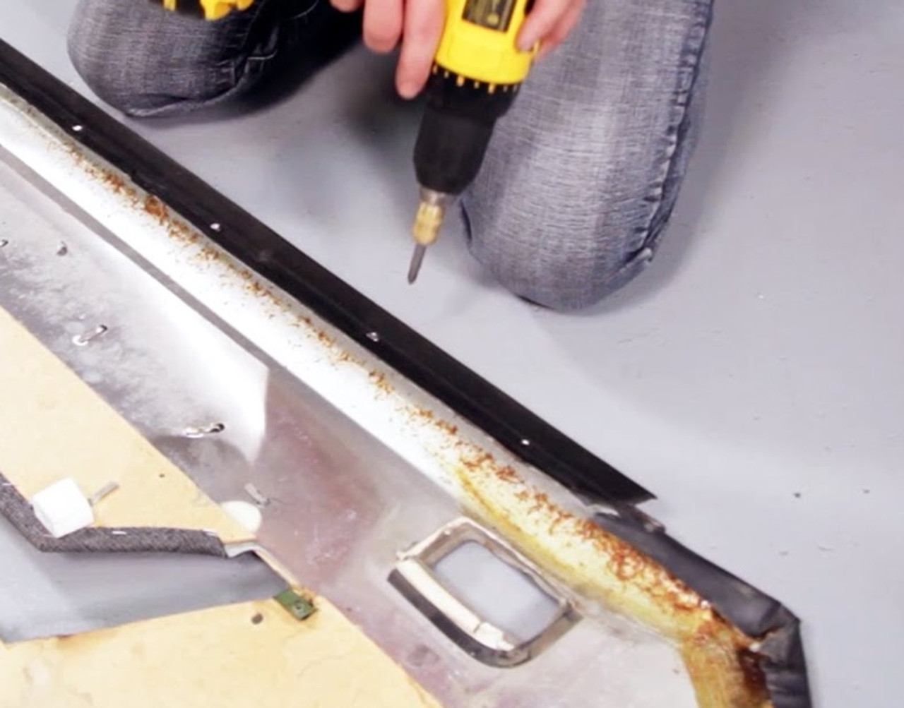 Horizontal or Belt Weatherstrip being replaced with screws on the Door Panel of a car