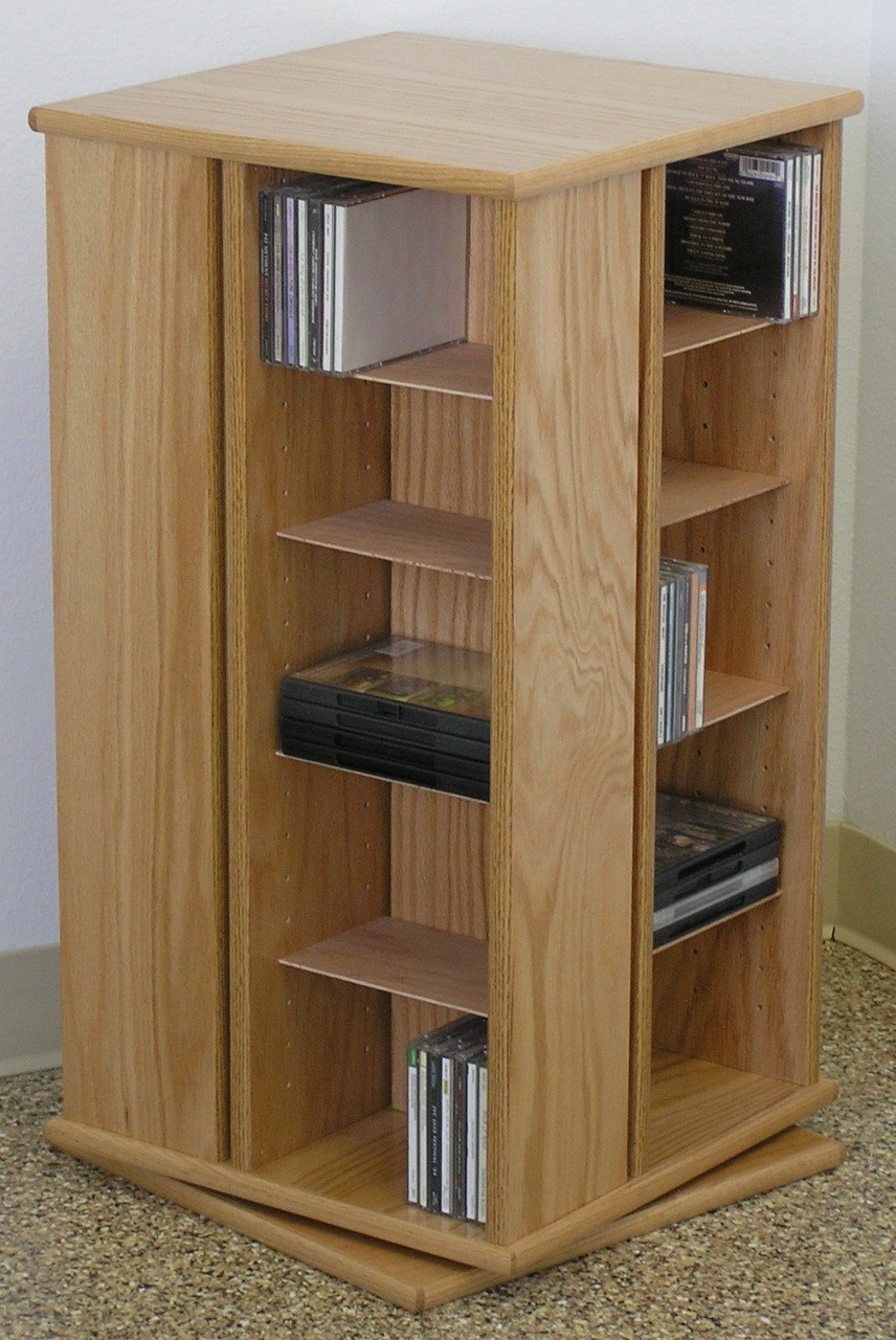 Swivel DVD storage cabinet 30 inches high shown in natural oak finish. & Swivel DVD storage cabinet 30