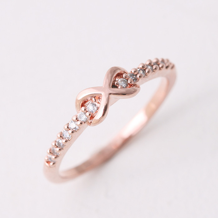 CZ Band Embraced Infinity Symbol Ring Rose Gold from kellinsilver.com