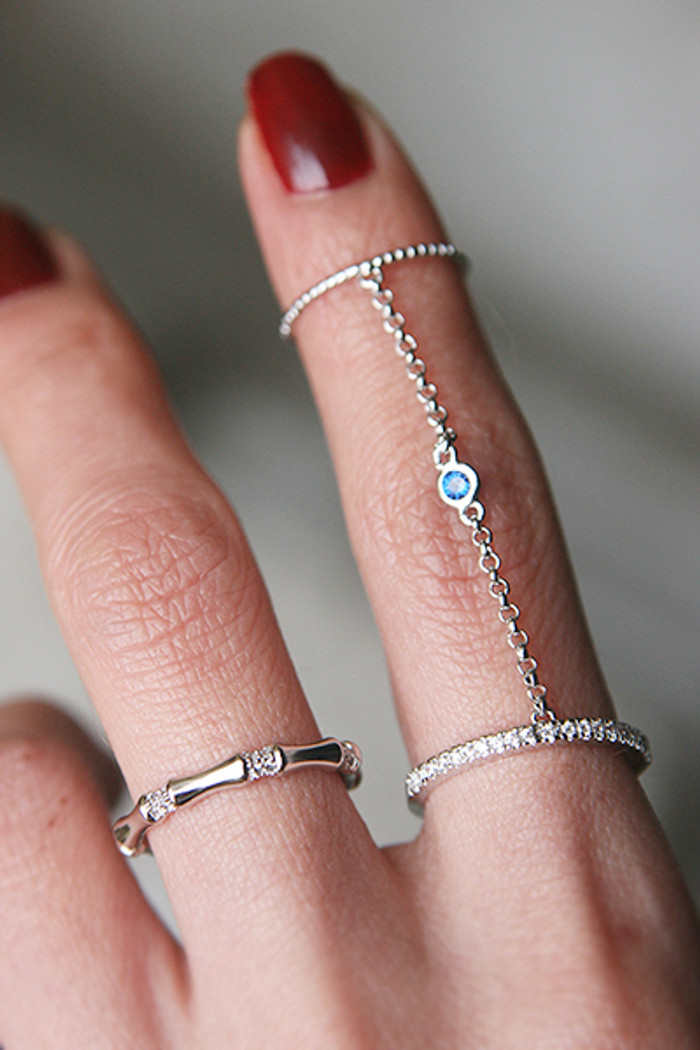 Blue Sapphire Bezel Two Finger Chain Ring White Gold from kellinsilver.com