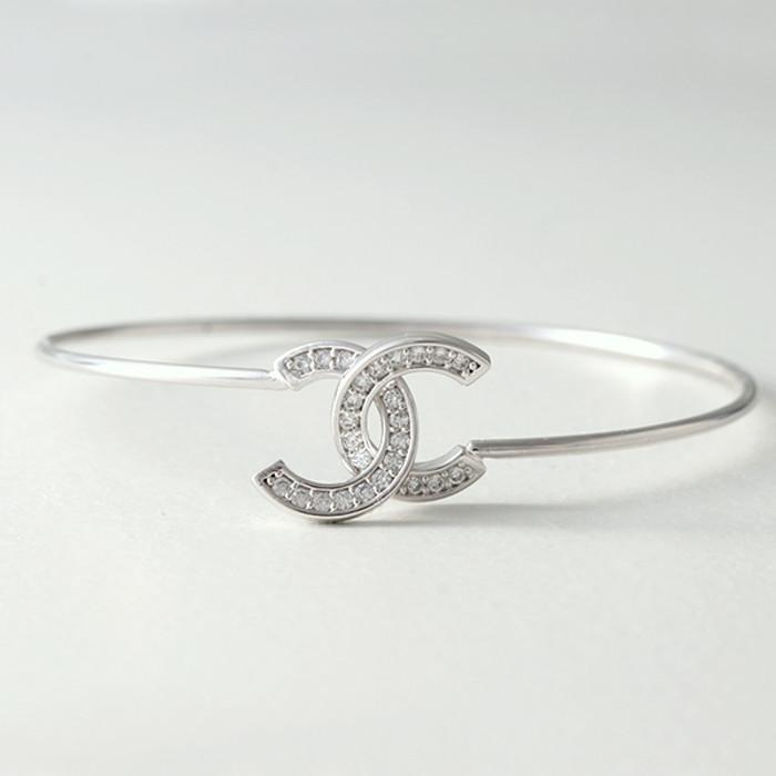 Swarovski White Gold Horseshoe Knot Bangle Bracelet from kellinsilver.com