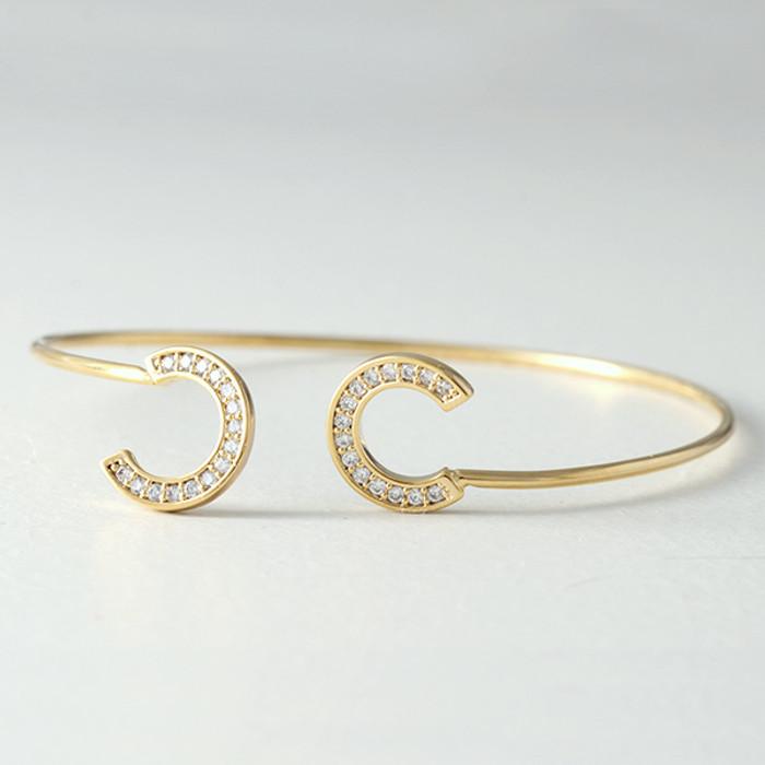 Swarovski Gold Horseshoe Knot Bangle Bracelet  from kellinsilver.com